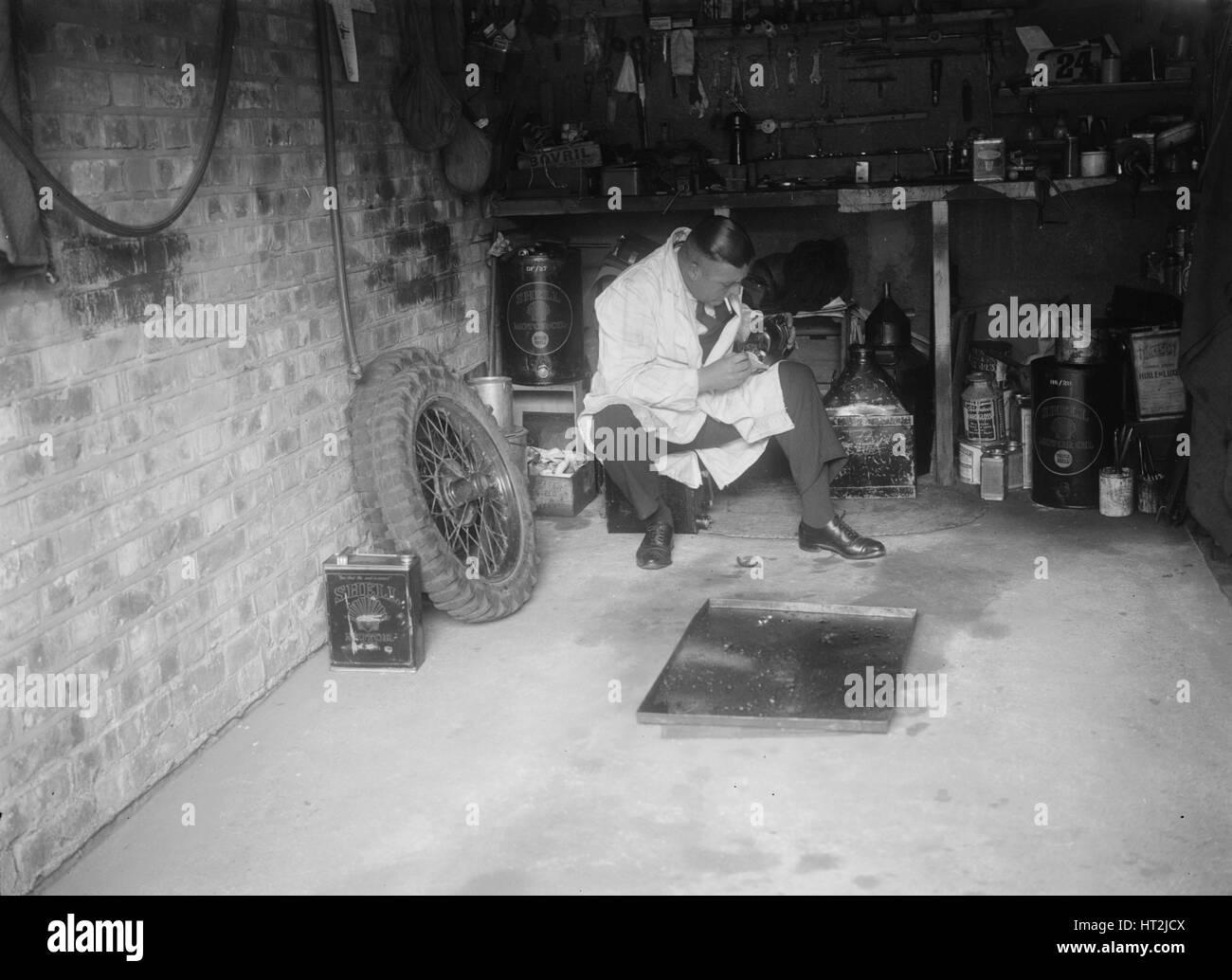 FA Thatcher in his garage. Artist: Bill Brunell. - Stock Image