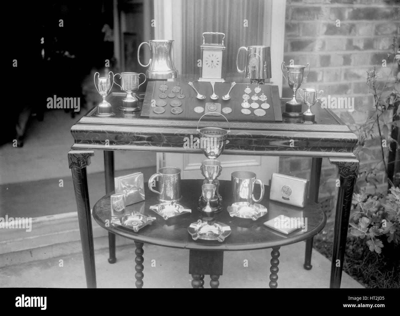 Motor sport trophies. Artist: Bill Brunell. - Stock Image
