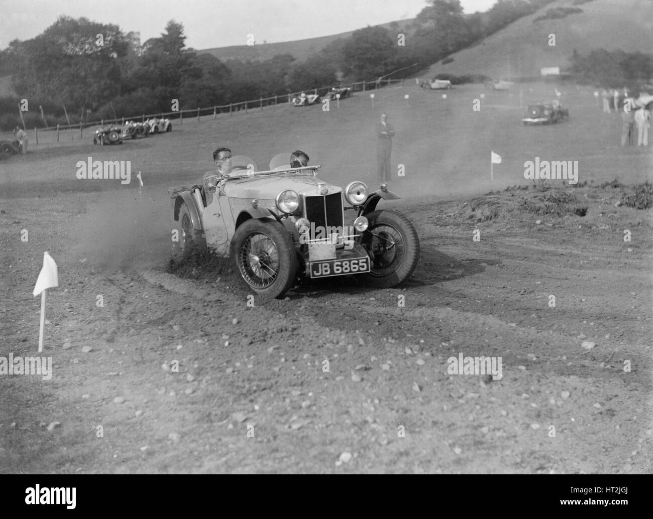 MG of L Welch of the Three Musketeers team at the Singer CC Rushmere Hill Climb, Shropshire 1935. Artist: Bill Brunell. - Stock Image