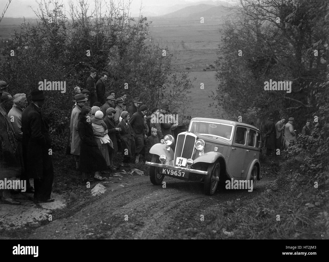 1934 Standard Ten taking part in a Standard Car Owners Club trial. Artist: Bill Brunell. - Stock Image