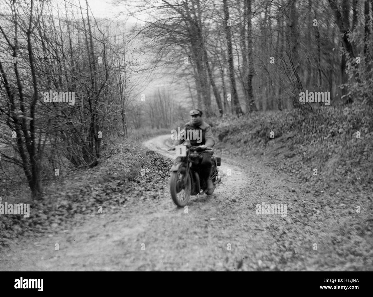 Motorcycle ridden by RD Quincy competing in the Inter-Varsity Trial, November 1931. Artist: Bill Brunell. - Stock Image