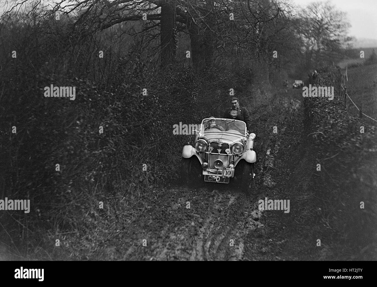 1935 1496 cc Singer Le Mans taking part in a motoring trial, 1936. Artist: Bill Brunell. - Stock Image
