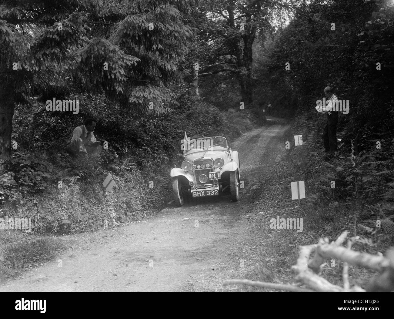 1934 Singer Le Mans of the Candidi Provocatores team taking part in a motoring trial, late 1930s. Artist: Bill Brunell. - Stock Image