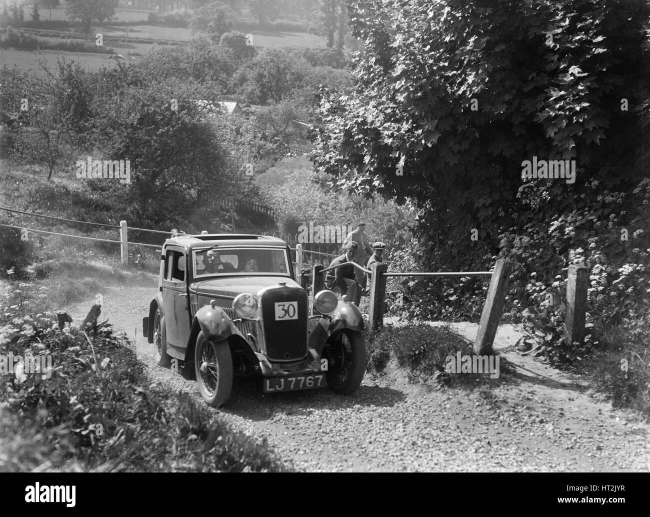 1933 Singer coupe taking part in a West Hants Light Car Club Trial, Ibberton Hill, Dorset, 1930s. Artist: Bill Brunell. - Stock Image
