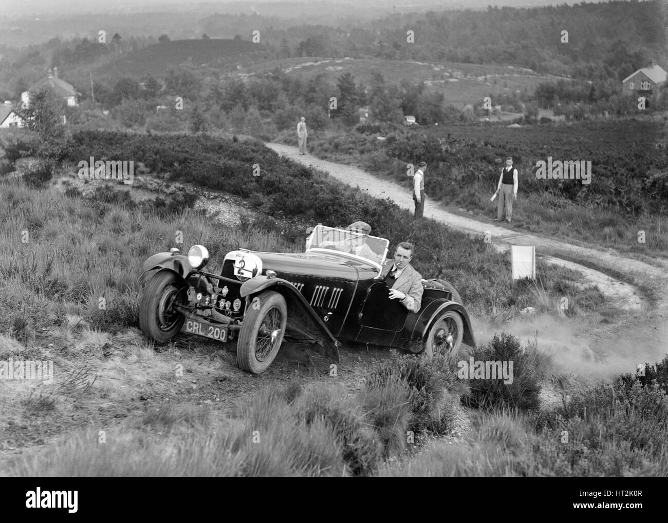 1937 HRG 2-seater sports of WP Uglow taking part in the NWLMC Lawrence Cup Trial, 1937. Artist: Bill Brunell. - Stock Image