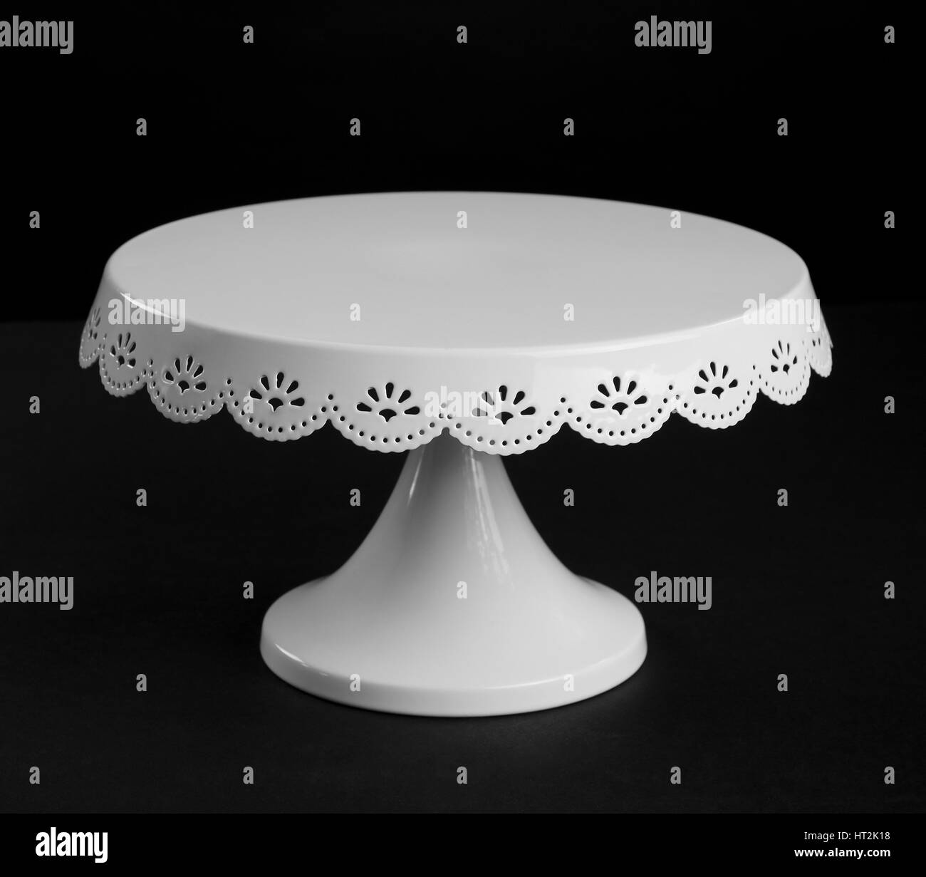 White metal cake stand on black background & White metal cake stand on black background Stock Photo: 135283156 ...