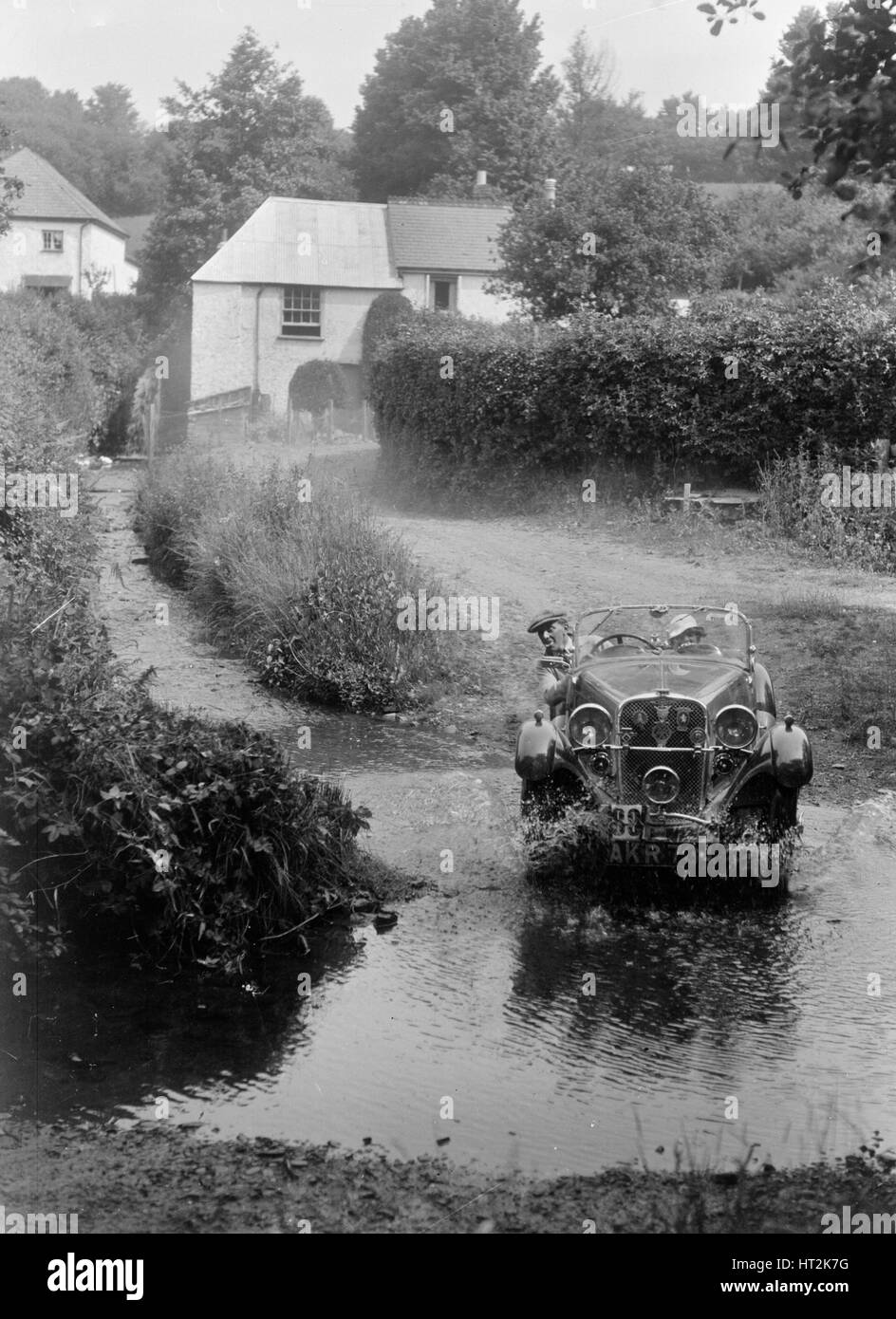 Singer competing in the B&HMC Brighton-Beer Trial, Windout Lane, near Dunsford, Devon, 1934. Artist: Bill Brunell. - Stock Image