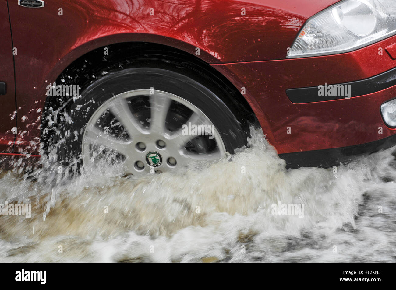 Car driving through flood. Artist: Unknown. - Stock Image