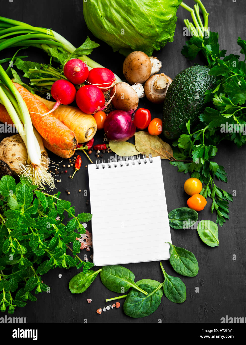 Healthy bio vegetables with recipe notebook radish cherry stock healthy bio vegetables with recipe notebook radish cherry tomatoes salad carrots spinach and spices forumfinder Image collections