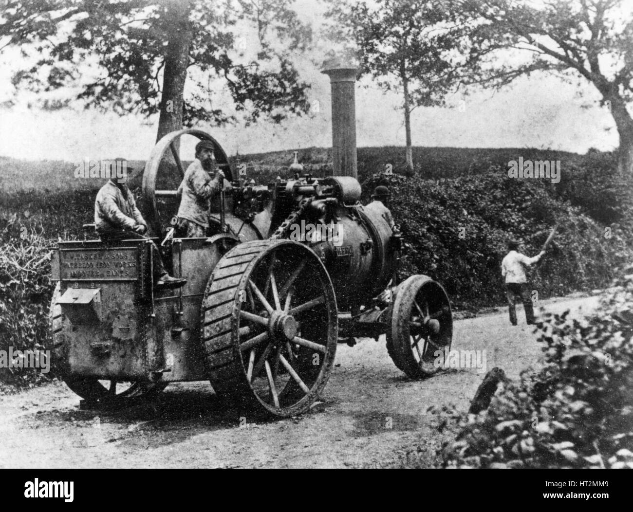 1869 Tasker traction engine with red flag man at the front - Stock Image