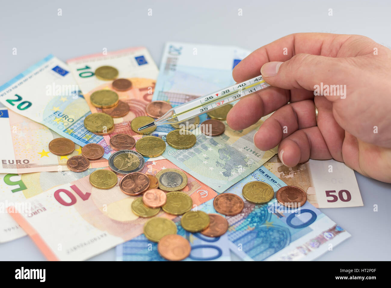Temperature thermometer symbolizes the worries about the euro. - Stock Image