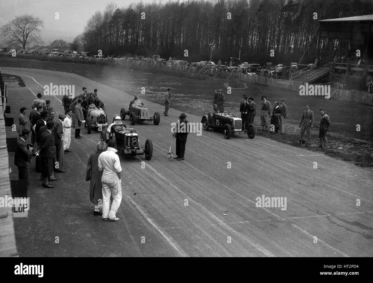 MG Q type, Frazer-Nash Shelsley and Bugatti Type 51 on the starting grid at Donington Park, 1930s. Artist: Bill - Stock Image