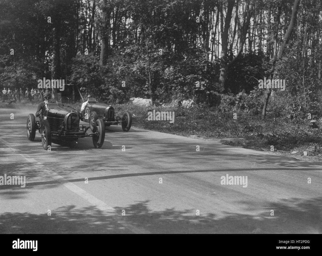 Bugattis of Jock Leith and Teddy Rayson racing at Donington Park, Leicestershire, 1935. Artist: Bill Brunell. - Stock Image