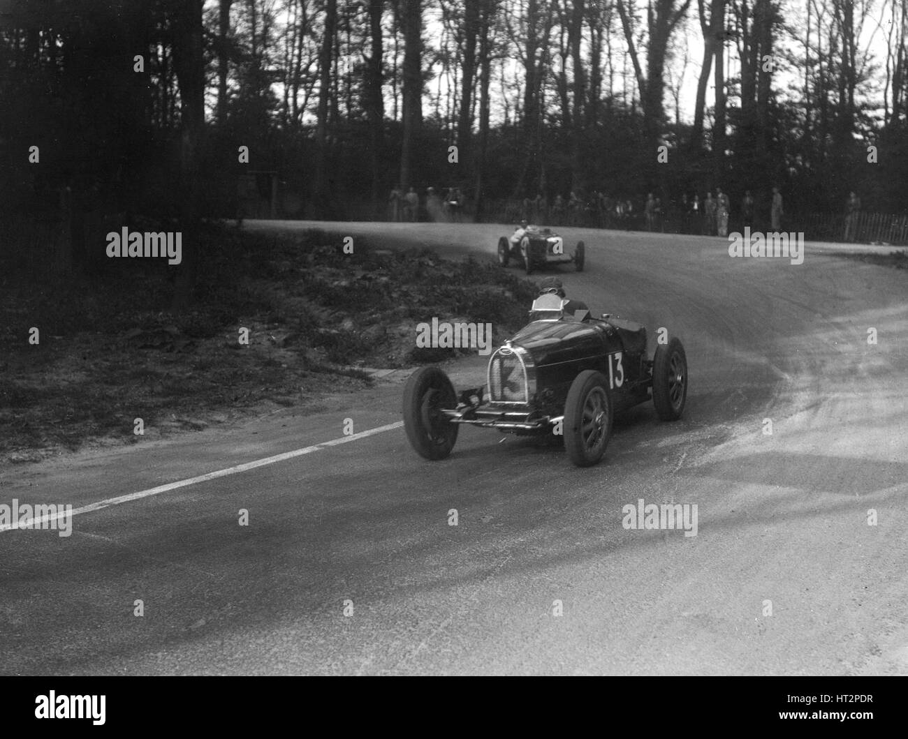 Bugatti Type 35B of Jock Leith leading a Riley Brooklands at Donington Park, Leicestershire, 1935. Artist: Bill - Stock Image