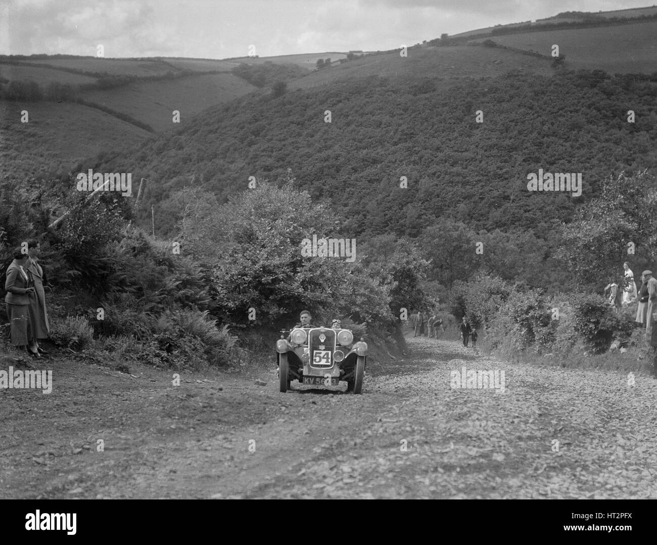 Singer 2-seater competing in the Mid Surrey AC Barnstaple Trial, Beggars Roost, Devon, 1934. Artist: Bill Brunell. - Stock Image