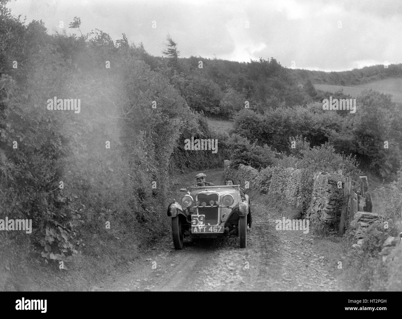 Singer open sports competing in the Mid Surrey AC Barnstaple Trial, 1934. Artist: Bill Brunell. - Stock Image