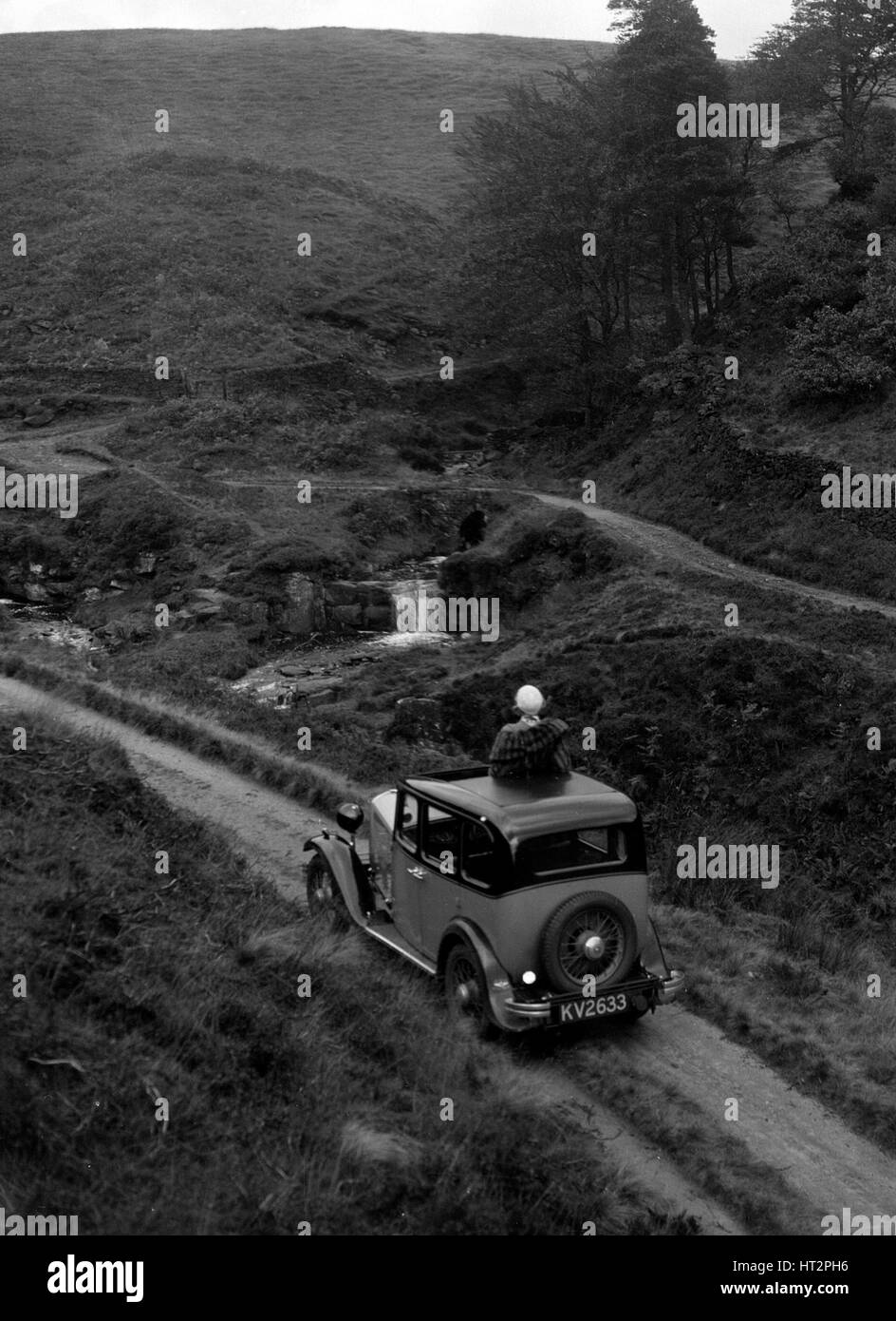 Kitty Brunell road testing a Standard Little Twelve saloon, c1932. Artist: Bill Brunell. - Stock Image