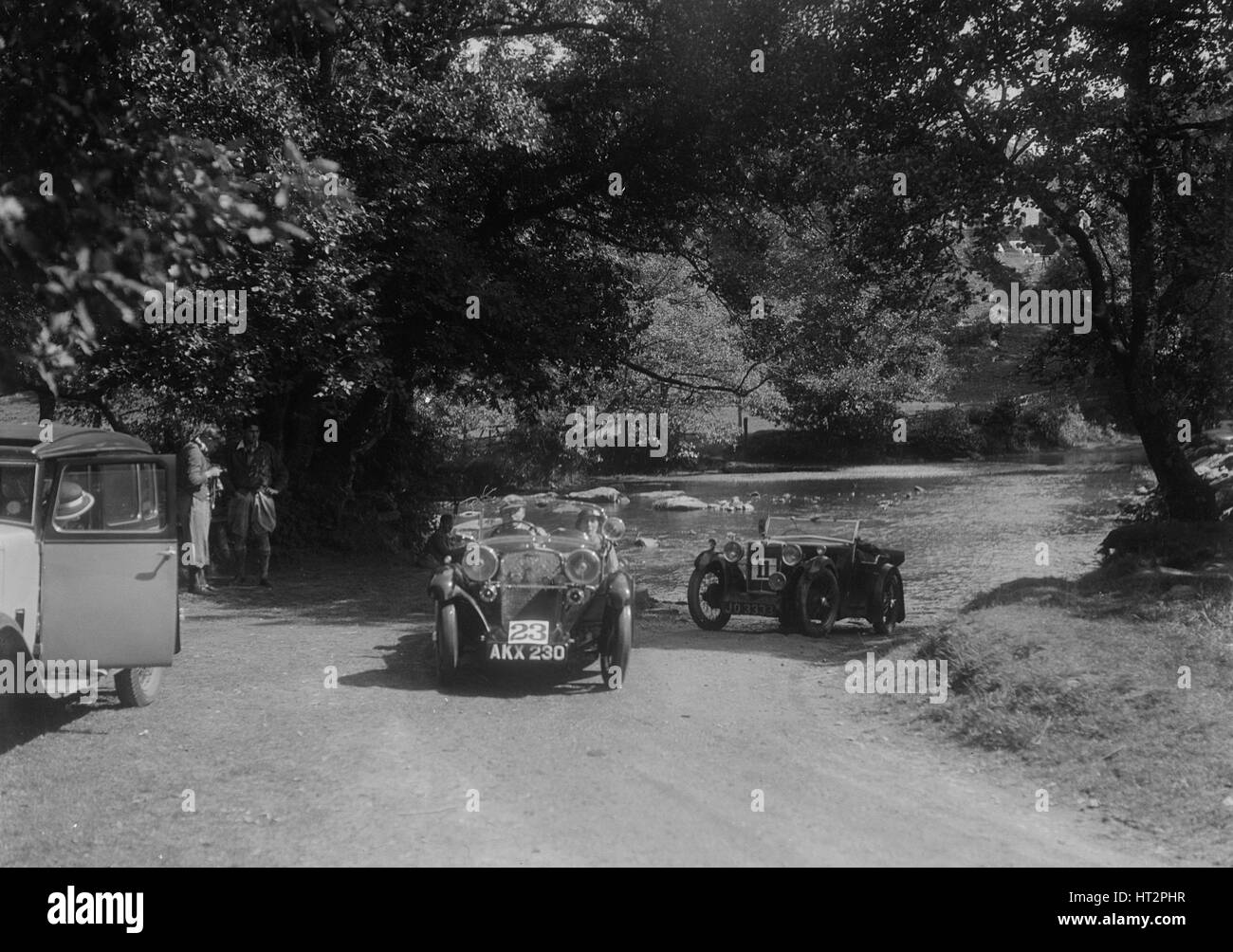 Singer Le Mans and MG D type at the Mid Surrey AC Barnstaple Trial, Tarr Steps, Exmoor, 1934. Artist: Bill Brunell. - Stock Image