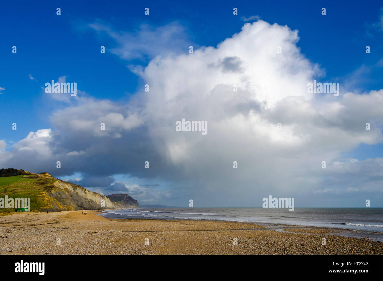 Charmouth, Dorset, UK. 6th Mar, 2017. UK Weather. A large shower cloud passes by Golden Cap, viewed from Charmouth - Stock Image