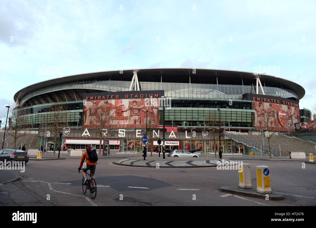 London, UK. 06th Mar, 2017. A cyclist passes the Emirates Stadium in London, England, 06 March 2017. Arsenal F.C. Stock Photo