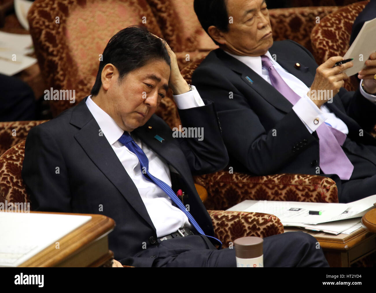 Tokyo, Japan. 6th Mar, 2017. Japanese Prime Minister Shinzo Abe listen to a question by an opposition lawmaker at - Stock Image