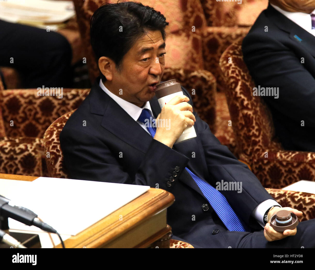 Tokyo, Japan. 6th Mar, 2017. Japanese Prime Minister Shinzo Abe drinks water at the Upper House budget committee - Stock Image