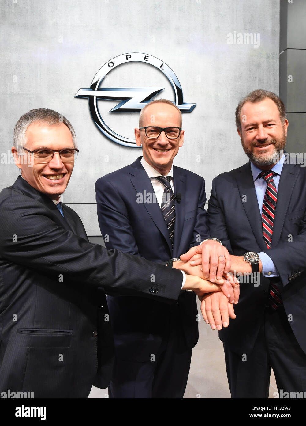 Geneva, Switzerland. 7th March 2017. From left, Carlos Tavares, chairman of the board at Peugeot and French PSA - Stock Image