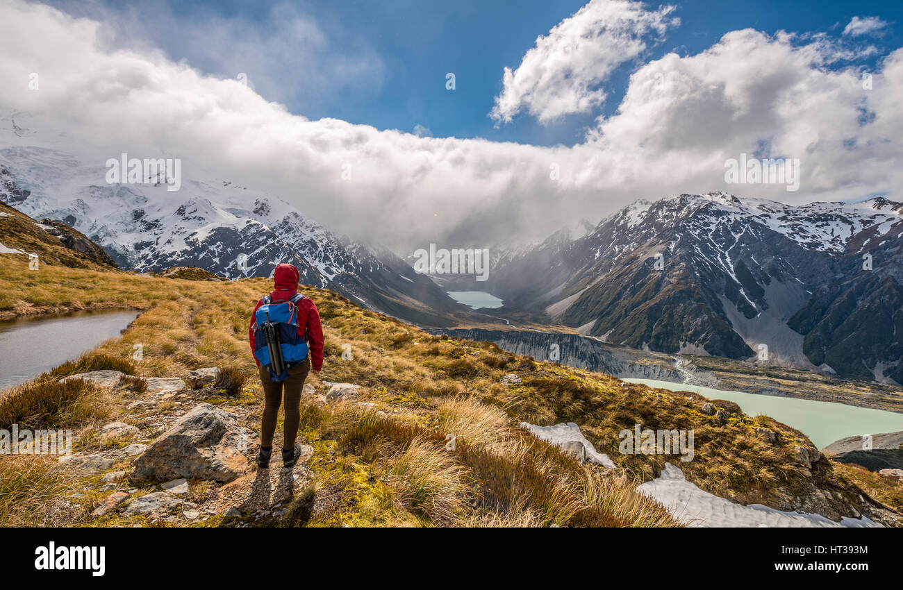 Hiker looking into Hooker Valley, mountain lake Sealy Tarns, Mount Cook National Park, Canterbury Region, Southland, - Stock Image