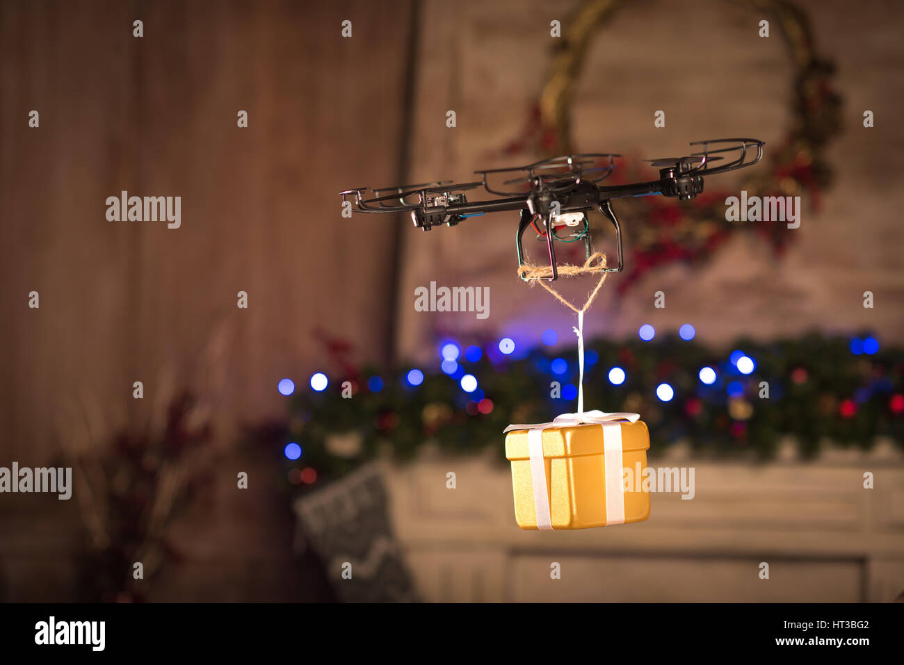 Hexacopter drone flying with gift box   - Stock Image