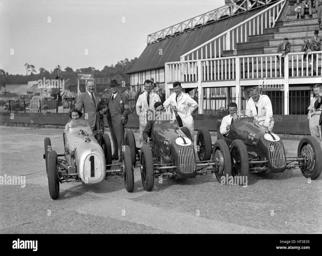 Austin 7 works team, Brooklands 1937. Artist: Bill Brunell. - Stock Image