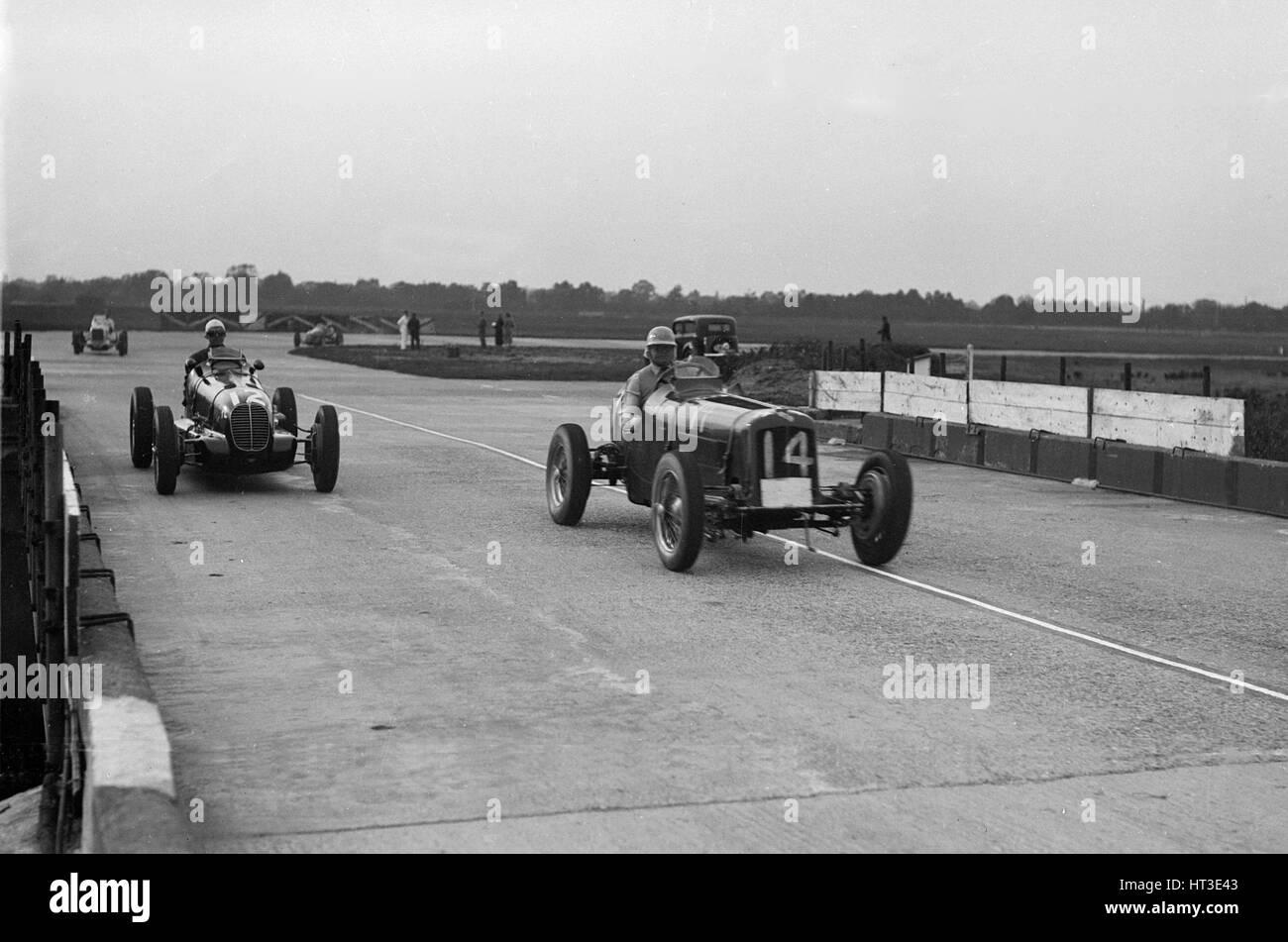 ERA and Maserati at Brooklands. Artist: Bill Brunell. - Stock Image