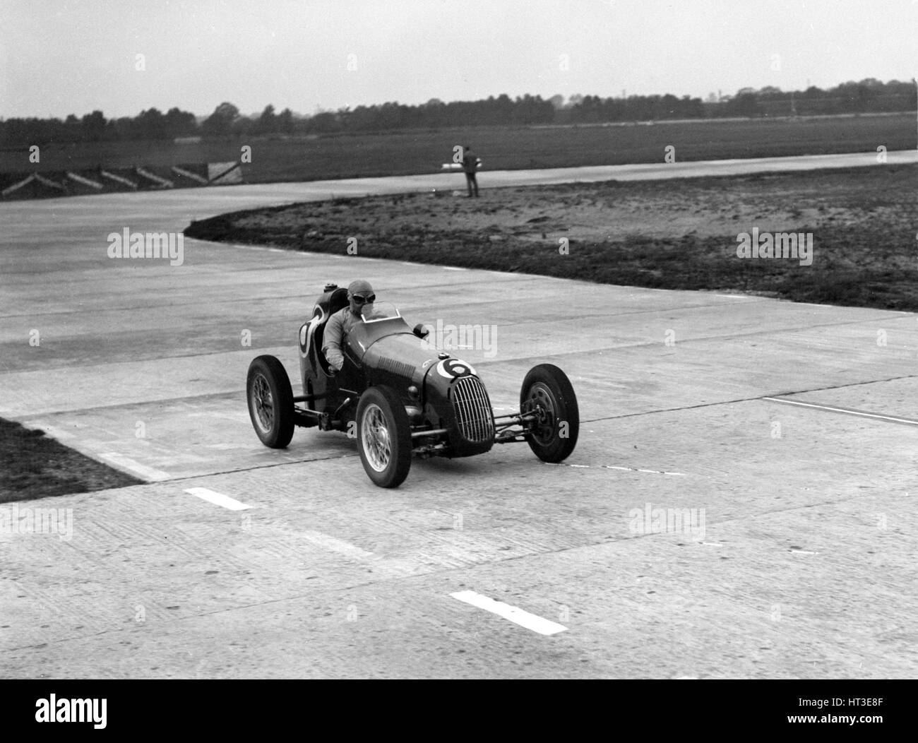 Austin 7 twin cam racing single seater on the Campbell Circuit, Brooklands. Artist: Bill Brunell. - Stock Image