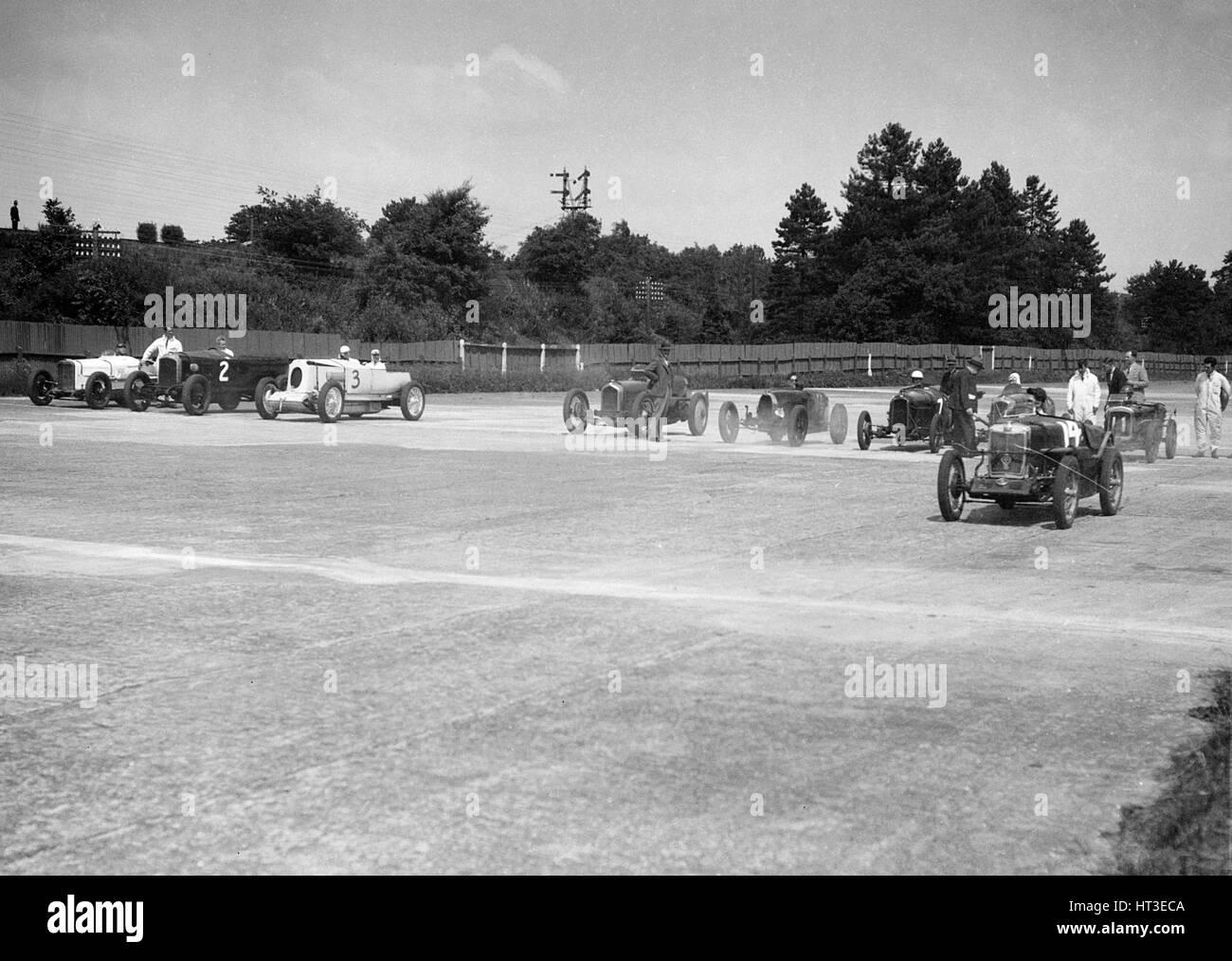 Motor racing at Brooklands. Artist: Bill Brunell. - Stock Image