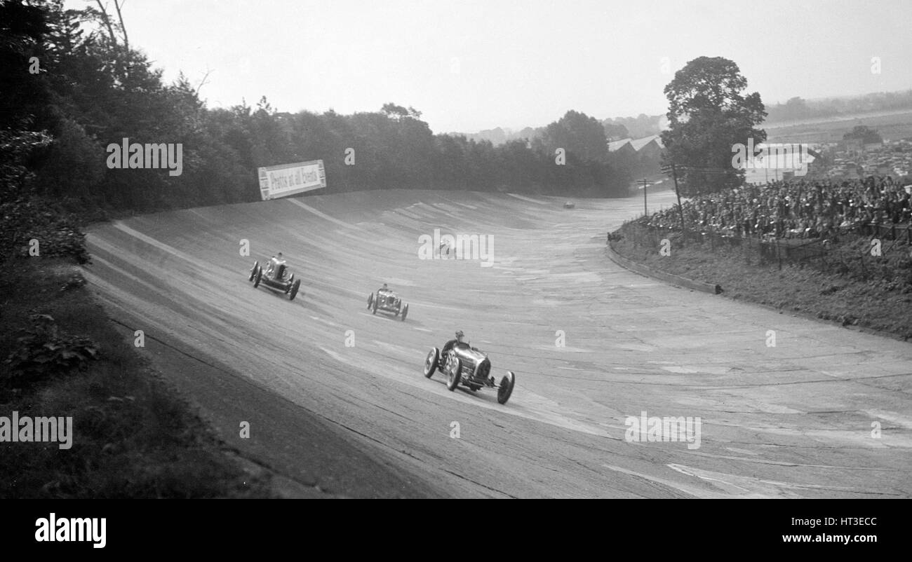 Bugatti Type 54 leading a Talbot 90 on the banking at Brooklands, 1930s. Artist: Bill Brunell. - Stock Image