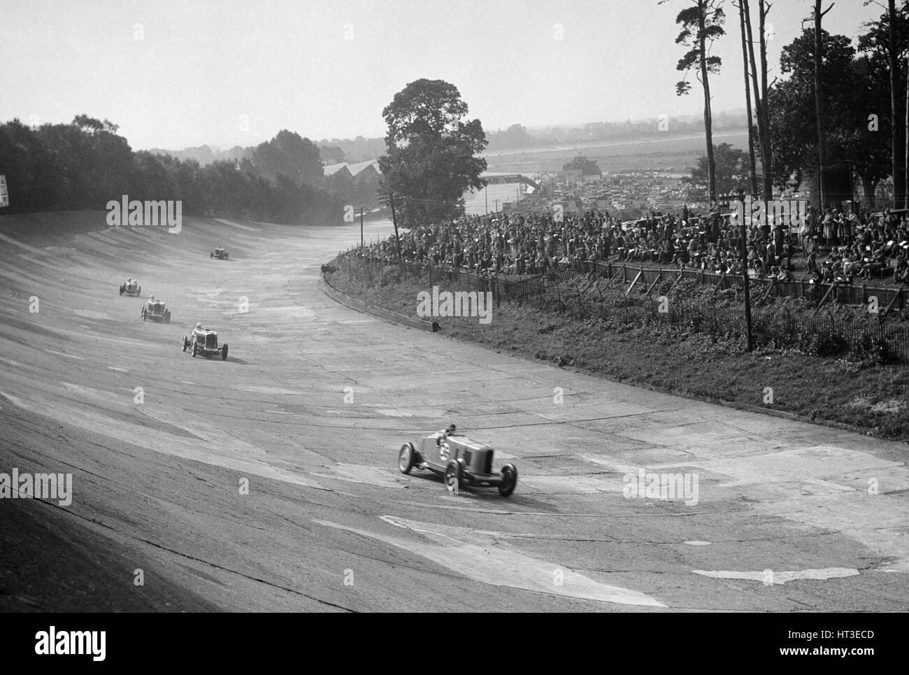 Talbot 90 on the banking at Brooklands, 1930s. Artist: Bill Brunell. - Stock Image