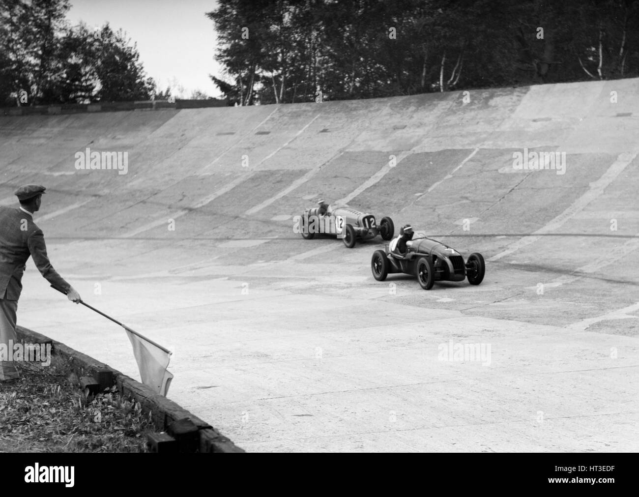 HC Hunter's Alta leading a Delahaye, JCC International Trophy, Brooklands, 2 August 1937.  Artist: Bill Brunell. - Stock Image