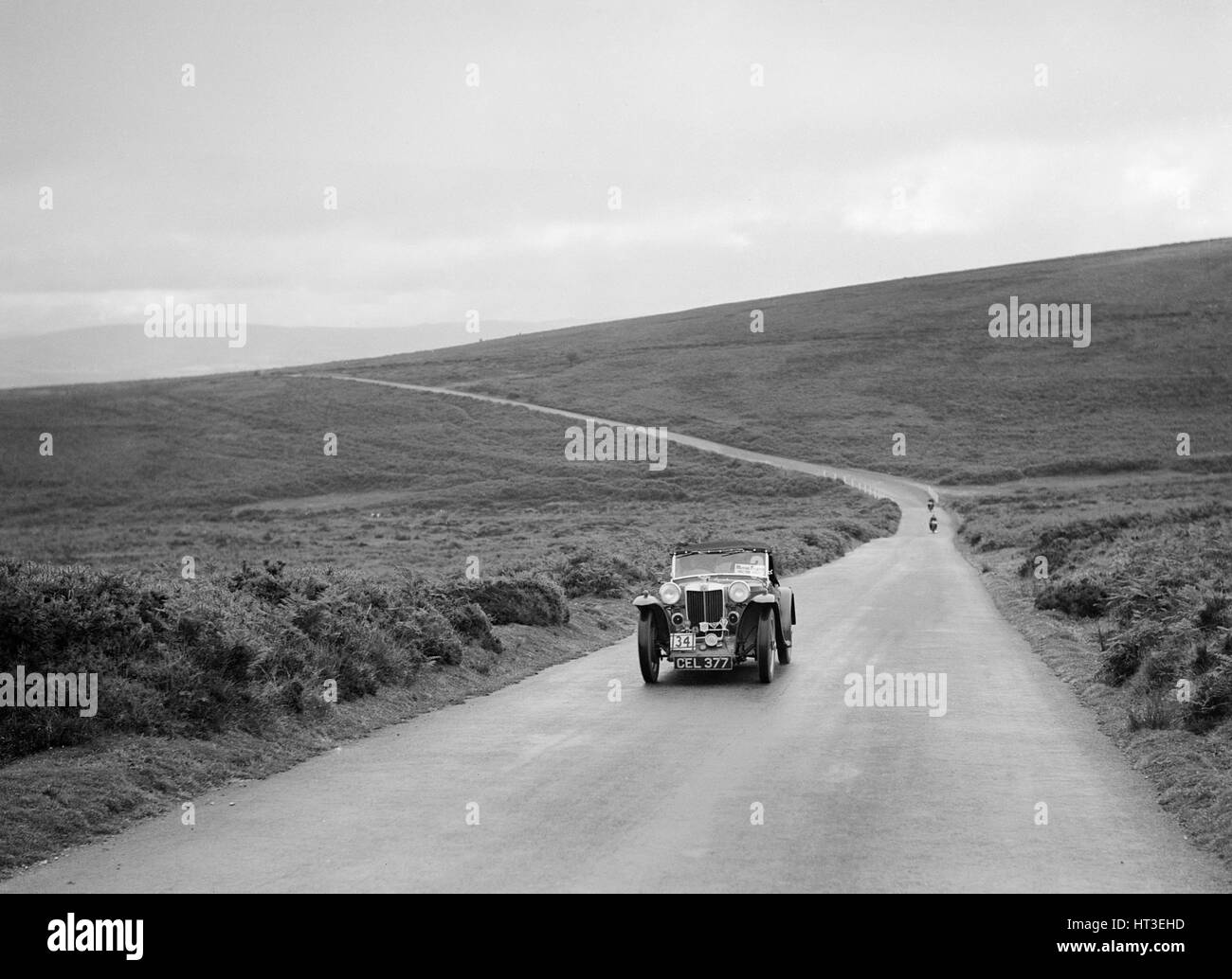 PG Sharp's MG PB competing at the MCC Torquay Rally, July 1937. Artist: Bill Brunell. - Stock Image