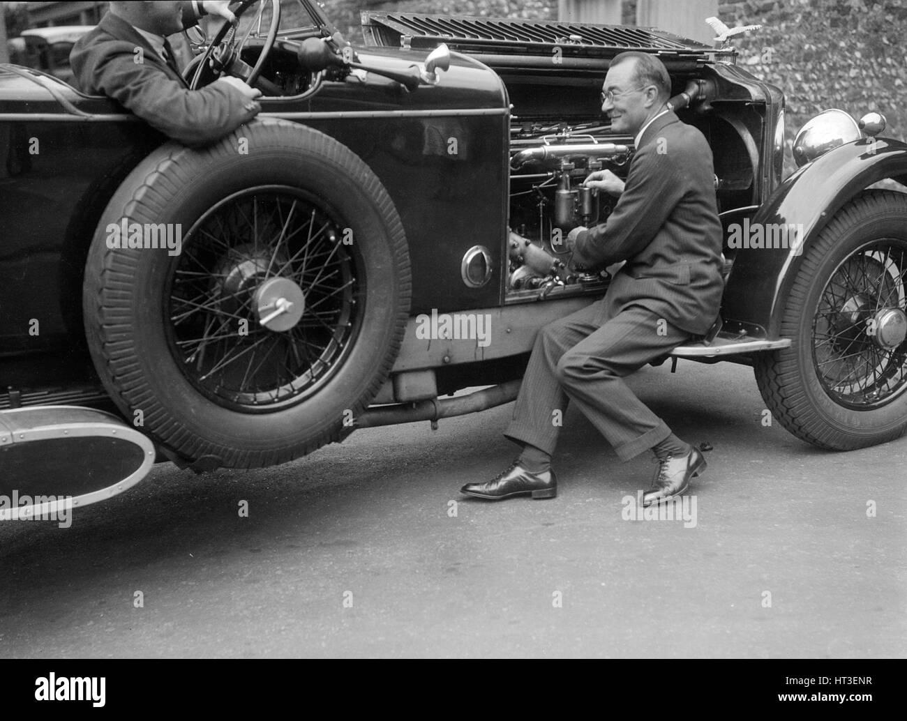 Geoffrey Baker inspecting the engine of a Minerva car. Artist: Bill Brunell. - Stock Image