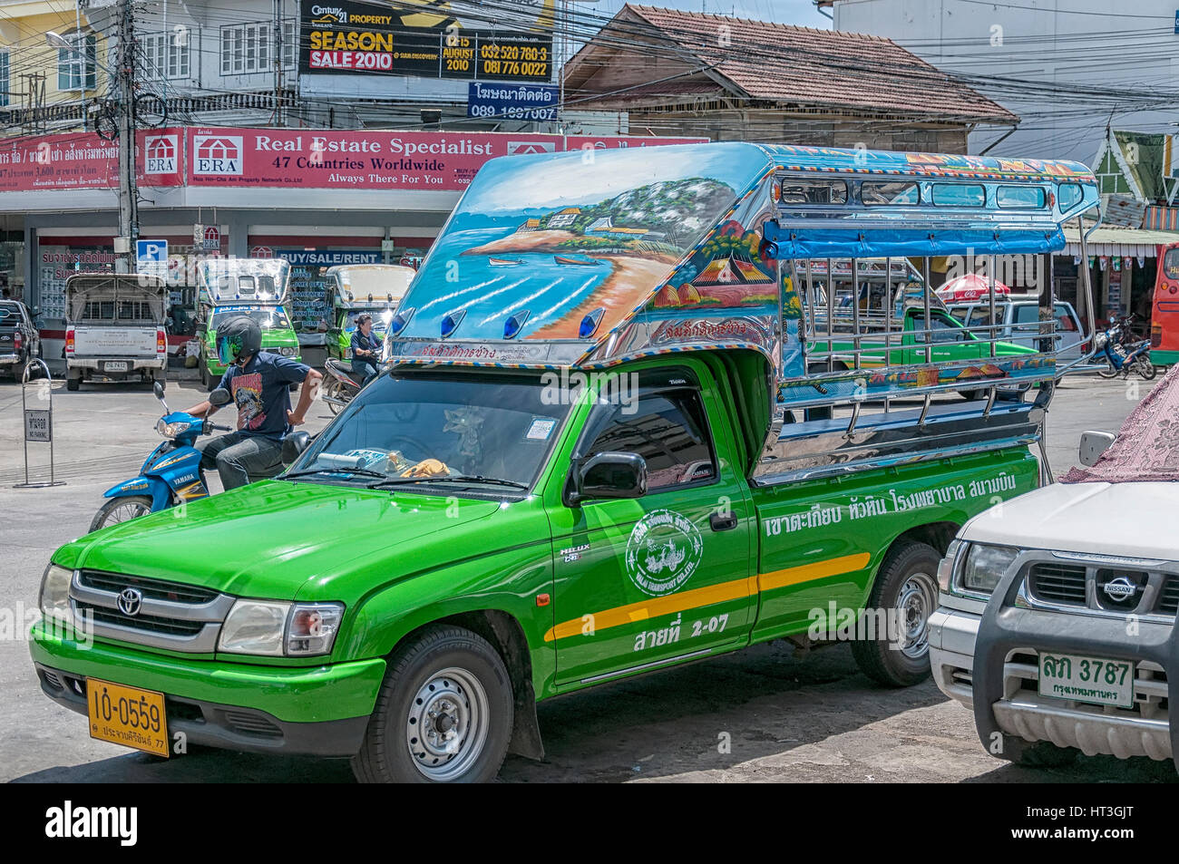 HUA HIN, THAILAND - SEPTEMBER 23, 2010: Songthaew pick-up truck in the center of Hua Hin. Songthaews are used as - Stock Image