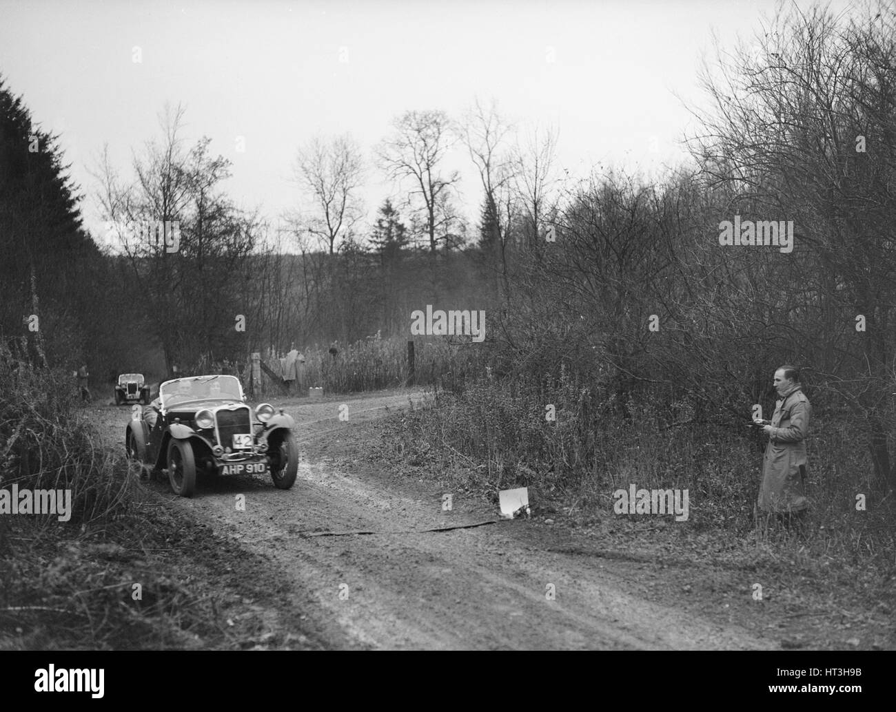 1935 972 cc Singer competing in the Great West Motor Club Thatcher Trophy, 1938. Artist: Bill Brunell. - Stock Image