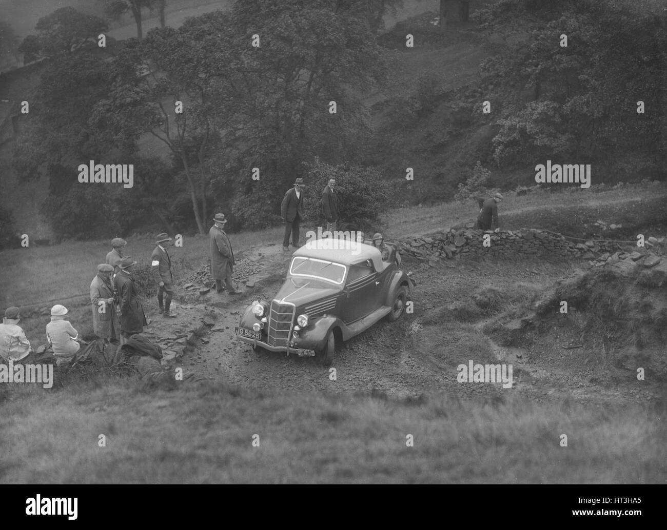 Ford V8 2-seater and dickey of JB Thompson competing in the MCC Sporting Trial, 1935. Artist: Bill Brunell. - Stock Image
