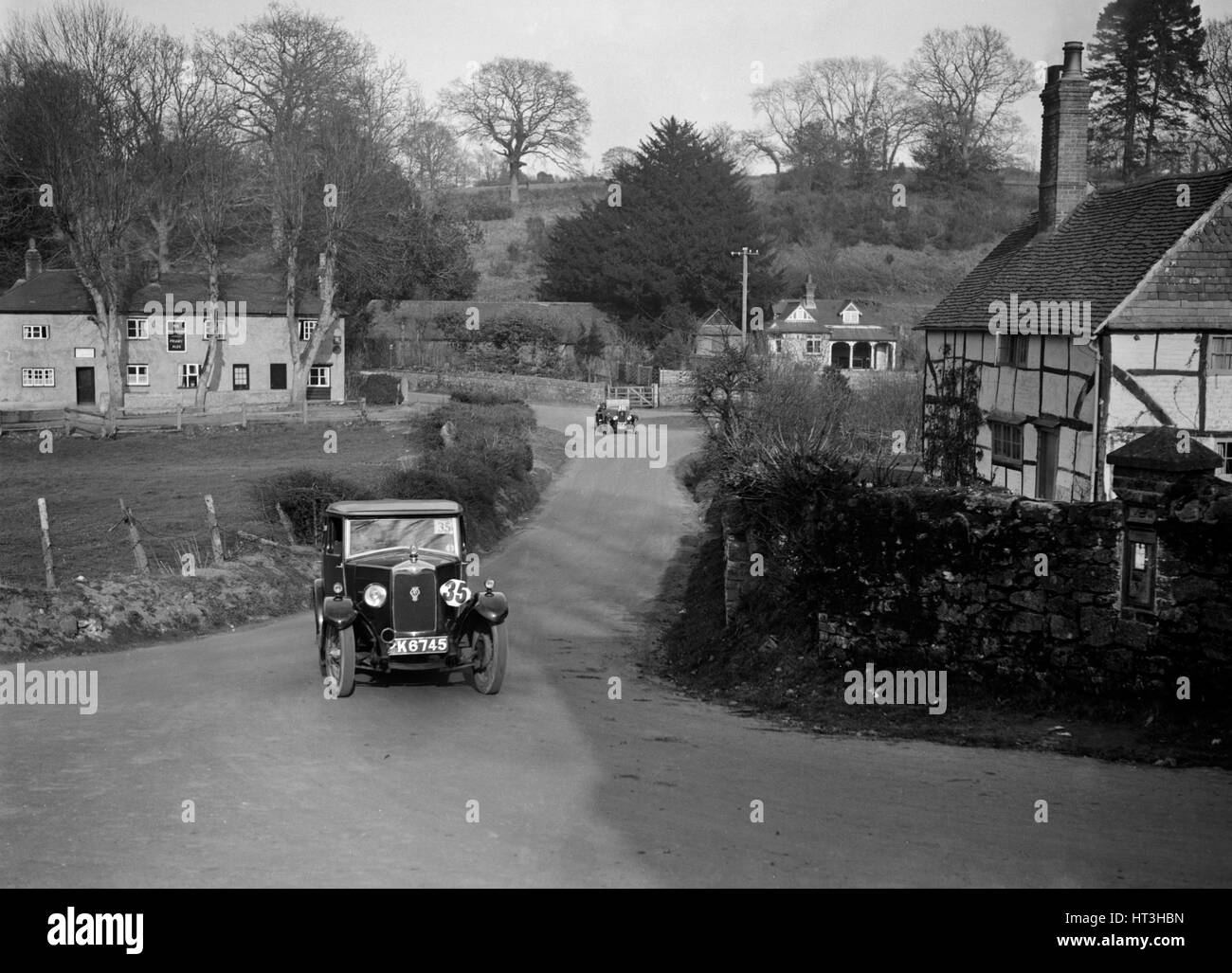 1929 1089 cc Riley competing in the JCC Inter-Centre Rally, Sutton, Surrey, 1932. Artist: Bill Brunell. - Stock Image