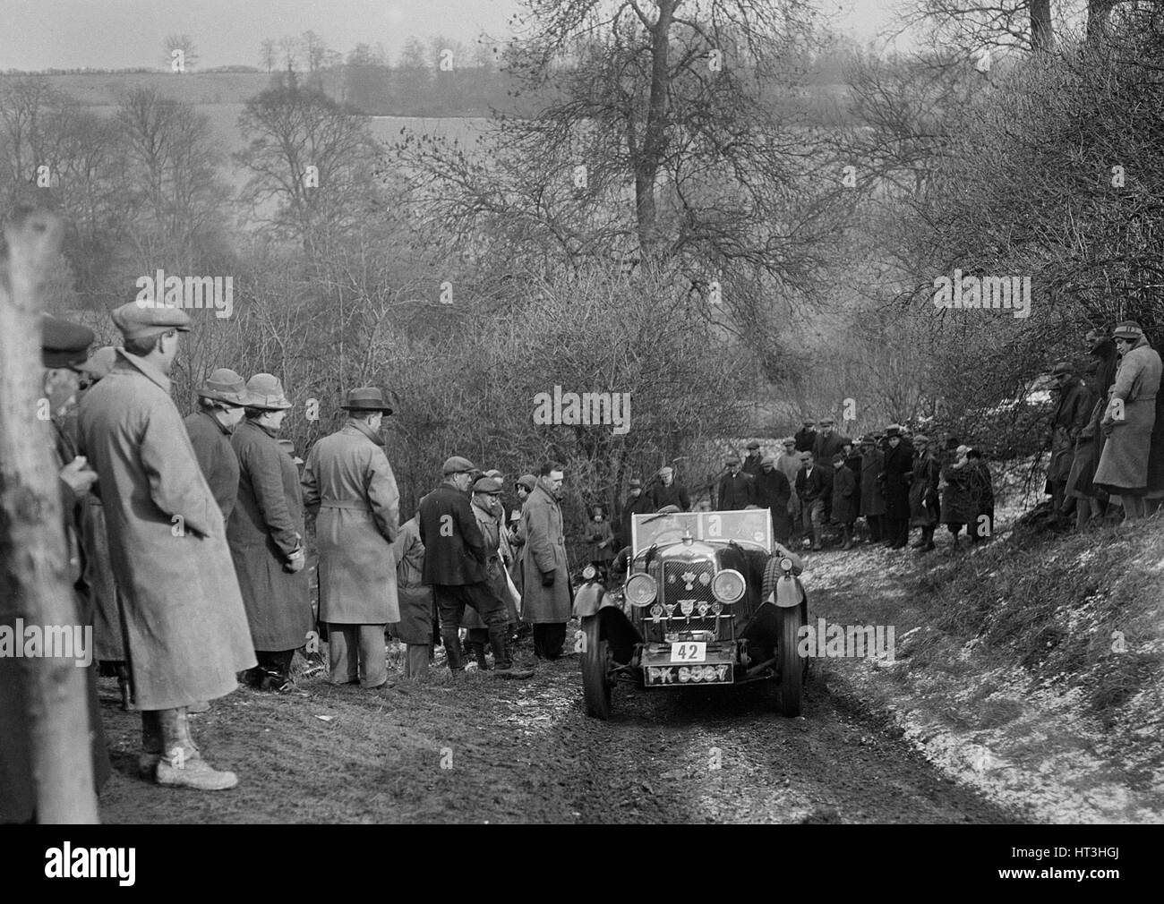Riley open 4-seater tourer of HC Hunter, North West London Motor Club London-Gloucester Trial, 1932. Artist: Bill - Stock Image
