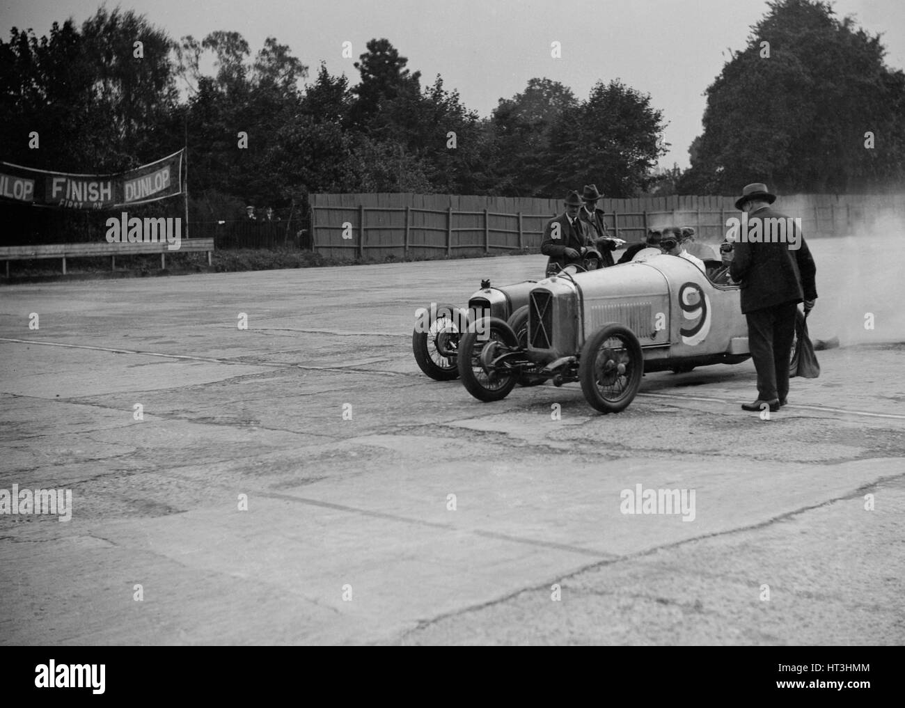 Salmson and Amilcar competing in a race at a Surbiton Motor Club meeting, Brooklands, Surrey, 1928. Artist: Bill - Stock Image