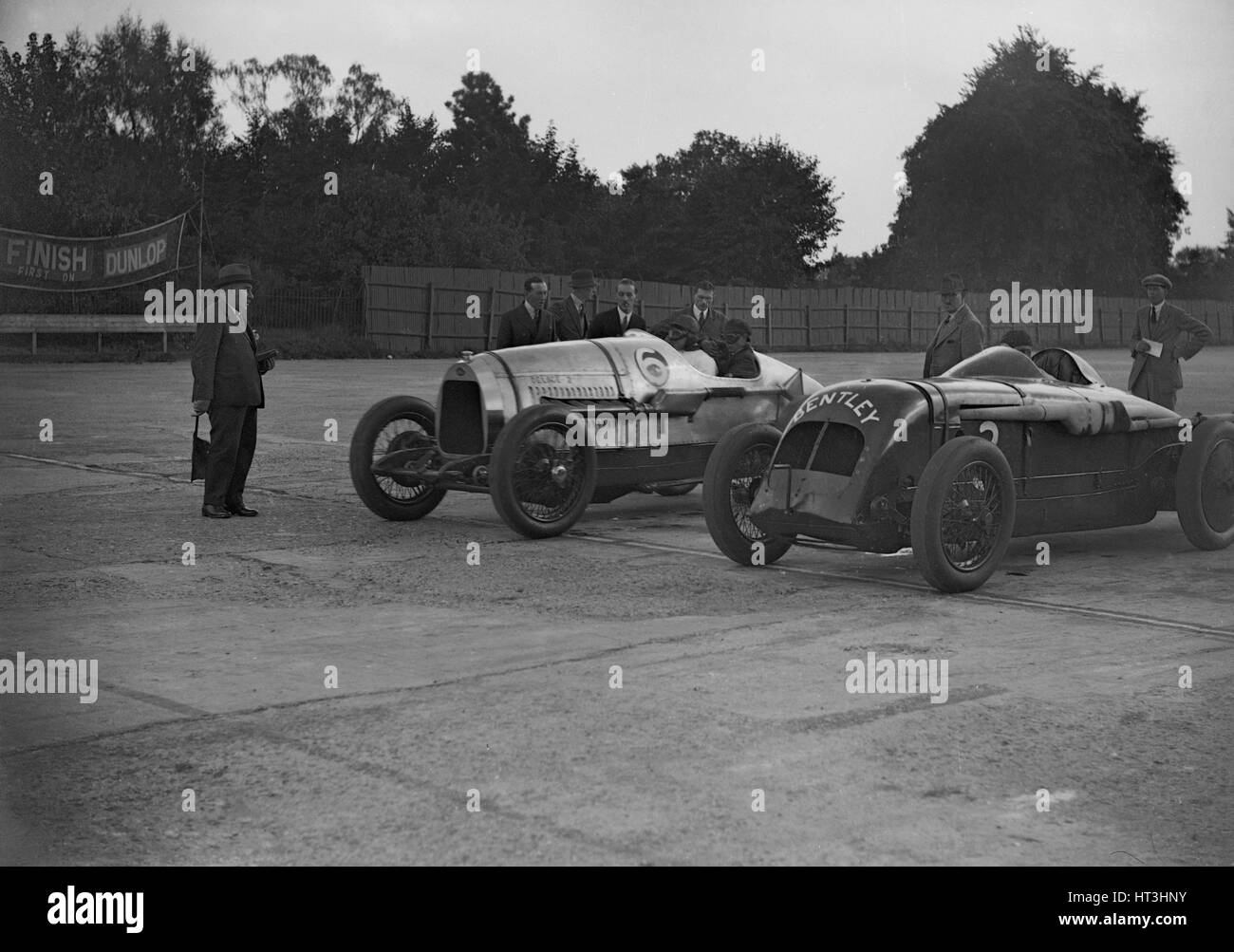 Delage of J Taylor and Bentley of Dudley Froy, Surbiton Motor Club race meeting, Brooklands, 1928. Artist: Bill - Stock Image