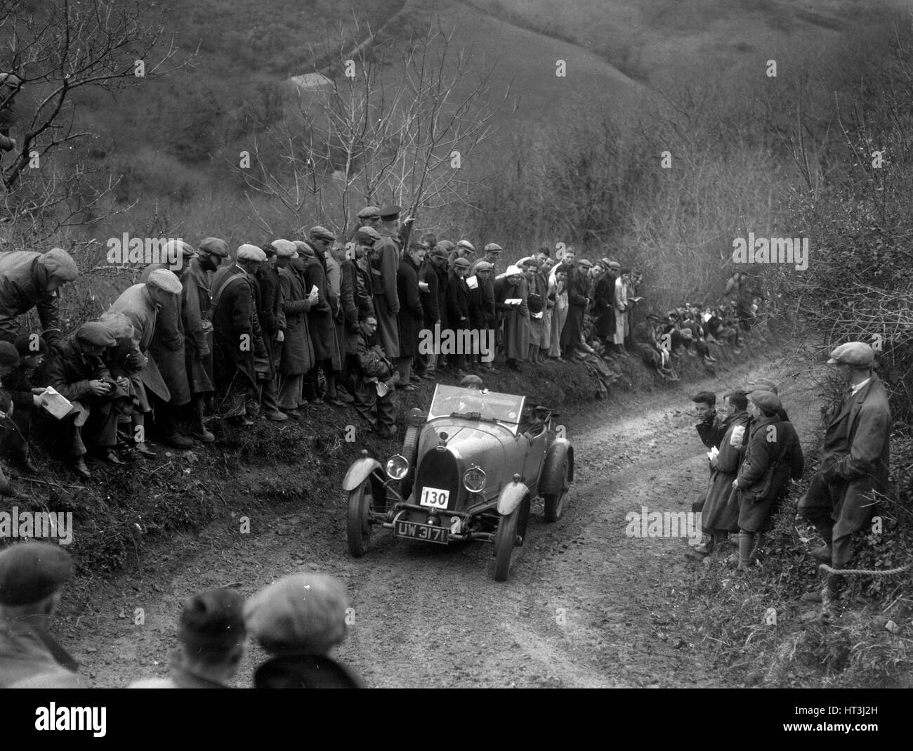 Bugatti Type 40 of KG Moss competing in the MCC Lands End Trial, 1935. Artist: Bill Brunell. - Stock Image
