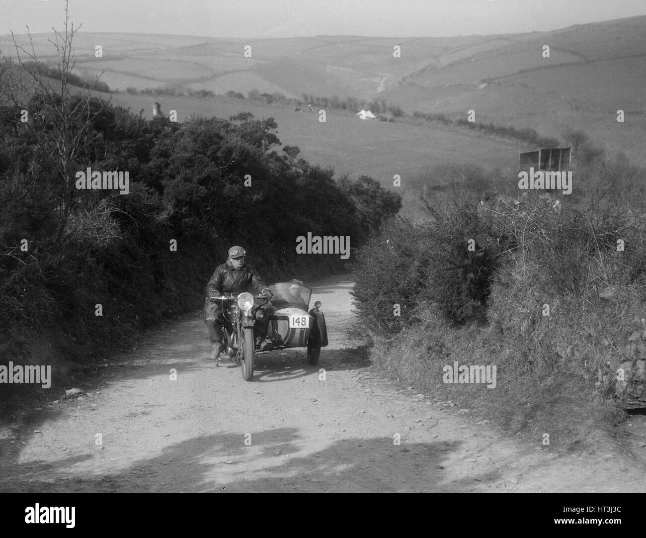 497 cc Ariel and sidecar of R Newman at the MCC Lands End Trial, Beggars Roost, Devon, 1936. Artist: Bill Brunell. - Stock Image