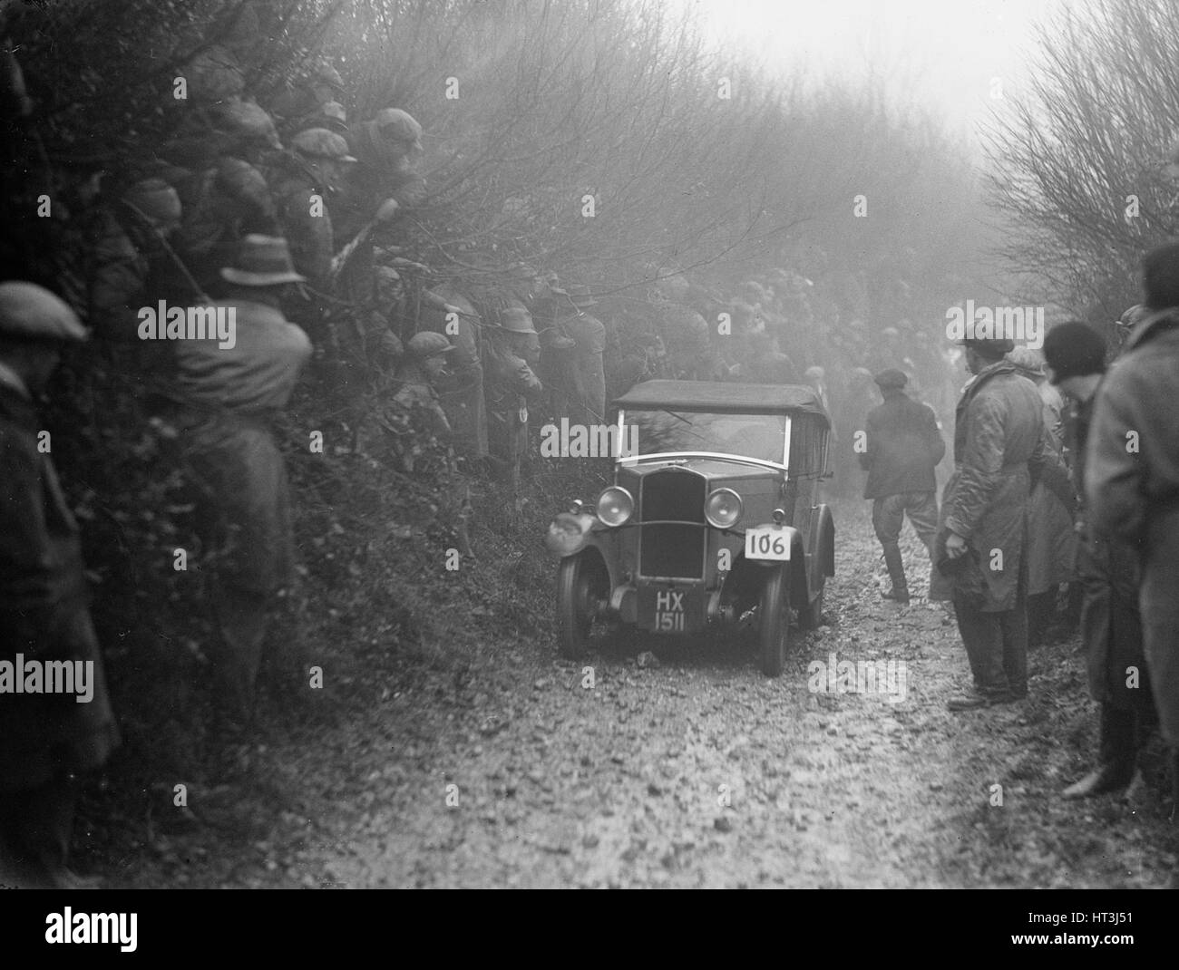 Triumph saloon of CH Lawford competing in the MCC Exeter Trial, 1930. Artist: Bill Brunell. - Stock Image