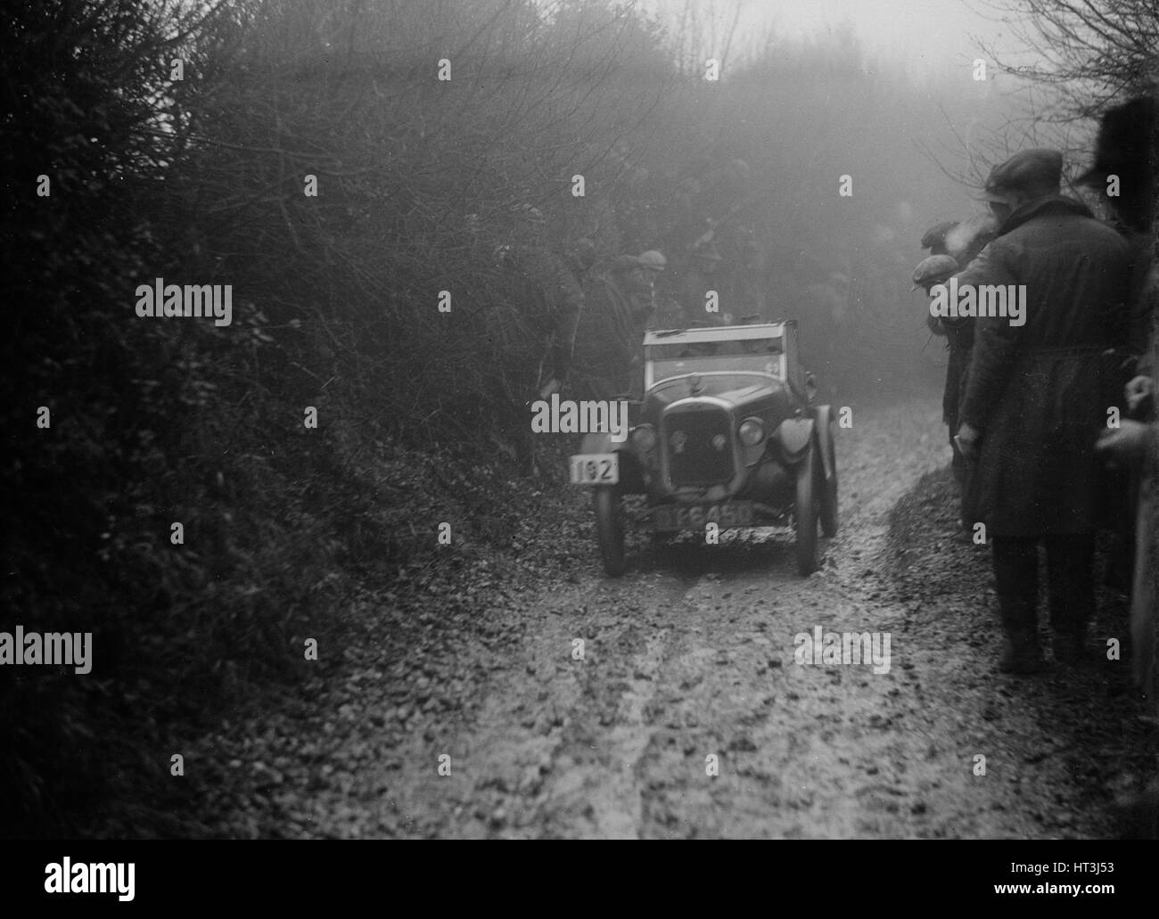Austin 7 of HC Jacobs competing in the MCC Exeter Trial, Meerhay, Dorset, 1930. Artist: Bill Brunell. - Stock Image