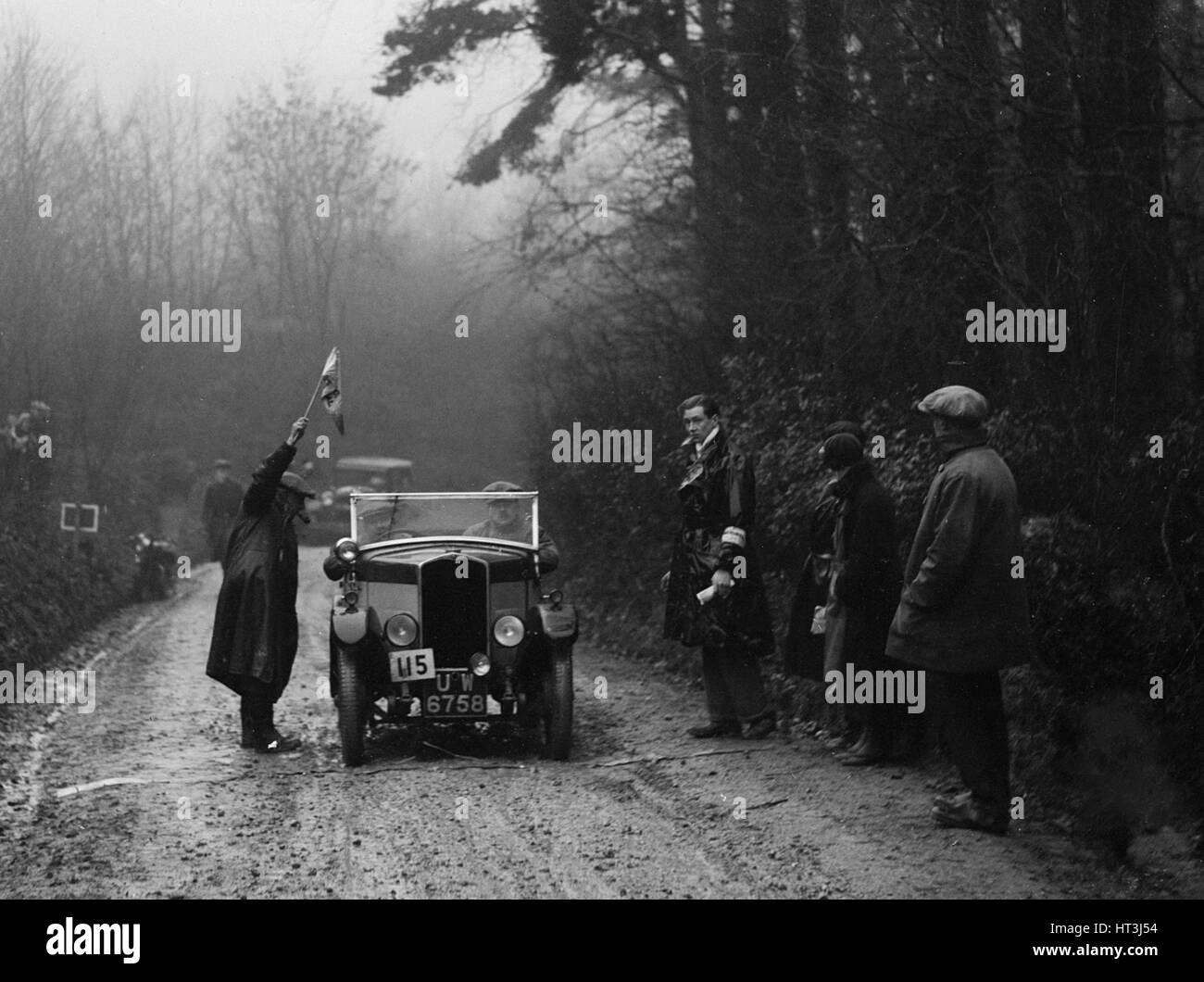 Triumph of J Wallis competing in the MCC Exeter Trial, 1930. Artist: Bill Brunell. - Stock Image